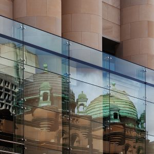 Queen Victoria Building, reflected in the glass of the Hilton Hotel.