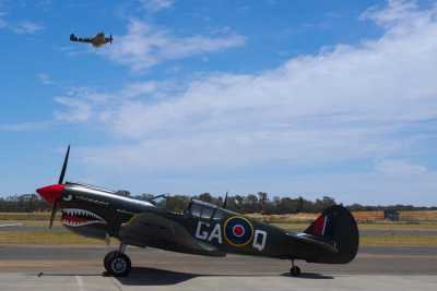 P-40 Kittyhawk GAQ owned by Allan Arthur, and Spitfire Mk VIII 'Grey Nurse' in flight.