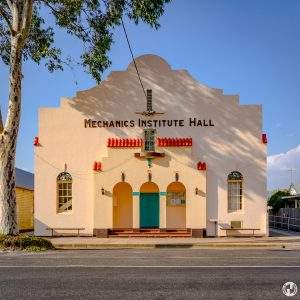 Mendooran Mechanics' Institute Hall, designed in an Inter-War Spanish Mission style by Sydney architect Walter Innes-Kerr. The building contractor was E. J. and W. J. Grainger of West Ryde, who completed the hall by December 1935, when it was officially opened at a grand ball.
