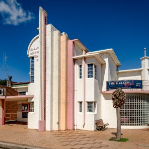 The Malachi Gilmore Hall in Oberon, NSW, designed by Italian architect Virgil Cizzio. The elaborate Art Deco facade contrasts with the large plain country hall behind. The hall was opened in 1937, built on land donated to the Catholic Church in memory of Malachi Gilmore.