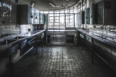 Callan Park Hospital, where meals were heated and served to the patients. On the other side of this kitchen is a dining area that looks out over Iron Cove, Russell Lea.