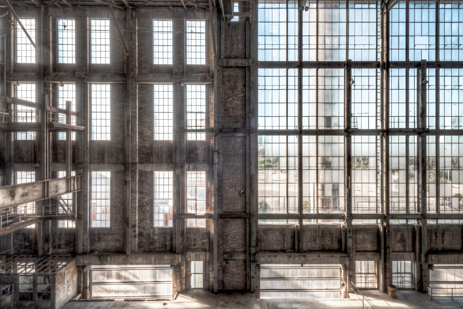 White Bay Power Station, looking across the Boiler House to a Chimney Stack rising through a wall of tall windows.
