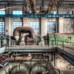White Bay Power Station. A broad view encompassing most of the turbine and its condenser beneath in the Turbine Hall.