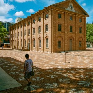 Hyde Park Barracks was designed by convict architect Francis Greenway, and completed in 1819. The building is at the southern end of Macquarie Street. There is currently an art installation in the courtyard by Jonathan Jones, which symbolise shared black and white history.